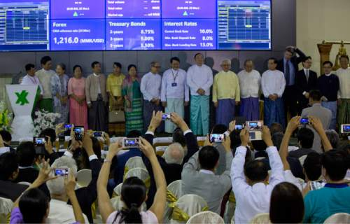 Electronic trading commences during the opening day of trading at Yangon Stock Exchange in Yangon, Myanmar, Friday, March 25, 2016. Myanmar's new stock exchange, the Yangon Stock Exchange (YSX) officially opened for business on Friday more than three months after it was launched in December 2015.(AP Photo/ Gemunu Amarasinghe)