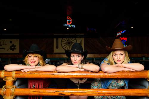 """Courtesy photo  Karia Danish (Mickey),  from left, Leenya Rideout (Jo) and Ashlie Roberson (Mo) perform in Pioneer Theatre Company's """"Cowgirls."""""""
