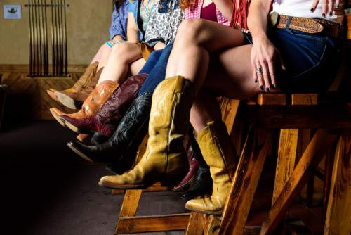"""Courtesy photo  The cast of Pioneer Theatre Company's """"Cowgirls"""" practice their country attitude in a publicity photo shoot at The Westerner."""