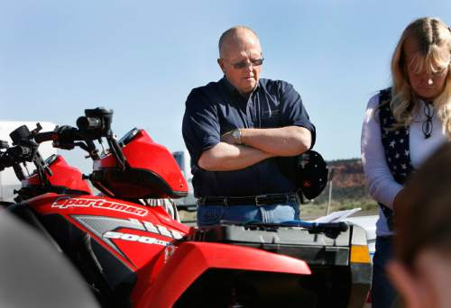 Scott Sommerdorf  |  The Salt Lake Tribune  Rep. Mike Noel, R-Kanab, prays with Shawna Cox at the beginning of an ATV protest ride in Paria Canyon in 2009.