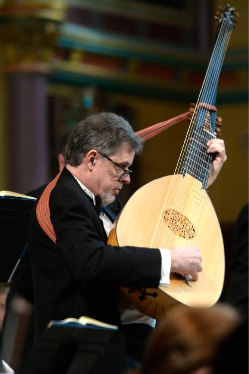 Leah Hogsten  |  The Salt Lake Tribune Lutenist Phillip Rukavina. American Festival Chorus presents St. Matthew Passion, by Johann Sebastian Bach, March 26, 2016 at The Cathedral of the Madeleine.  Bach wrote his St. Matthew Passion for a single purpose -- to present the Passion story in music at Good Friday vesper services. Bach's Passion retells the story of the events leading up to Jesus' crucifixion, dividing the music into two parts, first, the last supper and second, the betrayal and arrest of Jesus.