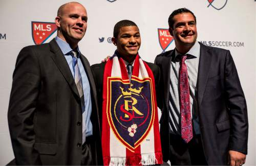 Tyler Gibbons  |  RSL  RSL SuperDraft pick Omar Holness of UNC (center), flanked by RSL general manager Craig Waibel (left) and head coach Jeff Cassar (right) at Thursday's MLS SuperDraft in Baltimore, Md.