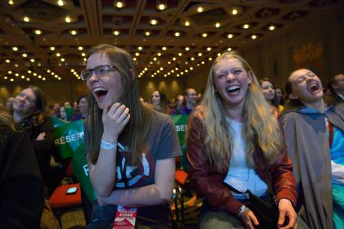 Leah Hogsten  |  The Salt Lake Tribune Brittany Casselman,left,  Alexis Wood and Sandra Edwards laugh at the words and antics of the Doctor Who cas at the Salt Lake Comic Con's FanX 2016 at the Salt Palace Convention Center on Friday.