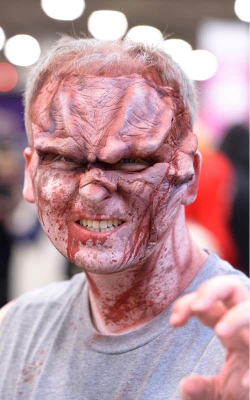 Leah Hogsten  |  The Salt Lake Tribune John Carlton sports a creepy face. Salt Lake Comic Con's FanX 2016 attendees mingle during the three-day pop-culture convention at the Salt Palace Convention Center, Friday, March 25, 2016.