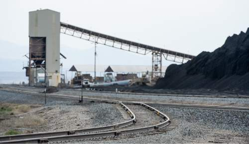 Francisco Kjolseth  |  The Salt Lake Tribune  Coal trucked from central Utah piles up at the Levan transfer station south of Nephi, where it is loaded on Union Pacific freight cars bound for California. Utah's Community Impact Board has awarded a $53 million loan to four coal-producing counties to invest in a deep-water port in Oakland, Calif. hoping to connect central Utah commodities with export markets. Bowie Resource Partners already exports about 1 to 3 million tons of coal from its Utah mines.
