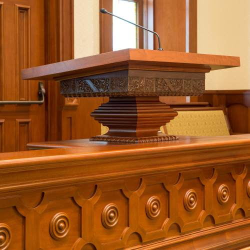 Photo courtesy The Church of Jesus Christ of Latter-day Saints  The tabernacleís pulpit was salvaged from the fire, restored, and returned to the temple chapel.