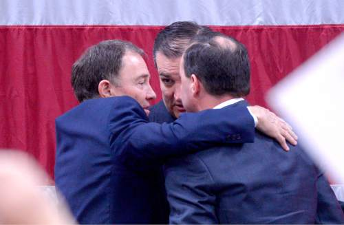 Leah Hogsten  |  The Salt Lake Tribune L-r Utah Governor Gary Herbert, Republican presidential candidate Texas Sen. Ted Cruz, R-Texas, and Sen. Mike Lee, R-Utah at the American Preparatory campus in Draper, Saturday, March 19, 2016 during a campaign rally for Lee.