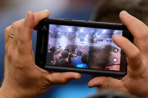 Trent Nelson  |  The Salt Lake Tribune A man takes a video of Carly Fiorina before a speech by Republican presidential candidate Ted Cruz at Provo High School in Provo, Saturday March 19, 2016. Also appearing were Senator Mike Lee and Glenn Beck.