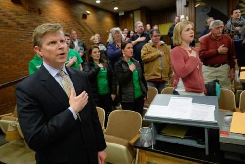Francisco Kjolseth | The Salt Lake Tribune Republican governor candidate Jonathan Johnson is joined by others in the reciting of the Pledge of Allegiance as he leads a precinct group for GOP caucus night on Tuesday night, March 22, 2016.