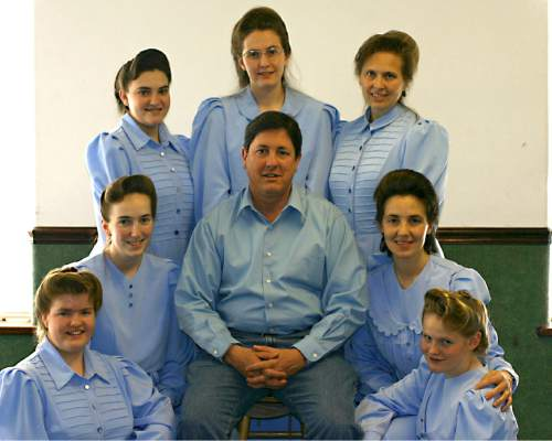 Courtesy  |  Sam Brower   Lyle Jeffs poses for a photo with seven of his nine wives circa 2005. From left: Luella Roundy, Lenora Bauer, Mable Jessop, Dianabel Barlow, Charlene Jeffs, Pauline Barlow and Margaret Stewart. Charlene was legally married to Lyle, but divorced him in 2015.