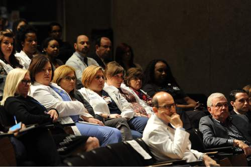 The transplant team sits in the auditorium during a news conference announcing the first-ever HIV-positive liver transplant in the world, at Johns Hopkins hospital , March 30, 2016 in Baltimore. Johns Hopkins University announced Wednesday that both recipients are recovering well after one received a kidney and the other a liver from a deceased donor, organs that ordinarily would have been thrown away because of the HIV infection. (AP Photo/Gail Burton)