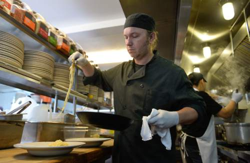 Francisco Kjolseth | The Salt Lake Tribune Chef Fred Moesinger of Caffé Molise prepares an order of pollo alla gratella. One of the best ways to enjoy some of Utah best restaurants, without breaking your wallet, is to go for lunch. Caffe Molise in downtown Salt Lake City, for example, offers the pollo alla gratella for lunch at $12.95 and dinner for $19.95 but with a larger portion at night that includes, mashed potatoes and a salad.