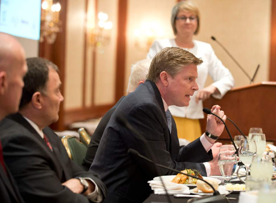 Lennie Mahler  |  Tribune file photo  Republican gubernatorial candidate Jonathan Johnson, seated next to Gov. Gary Herbert at a Utah Foundation debate, alleges wrongdoing in the release of his private information.