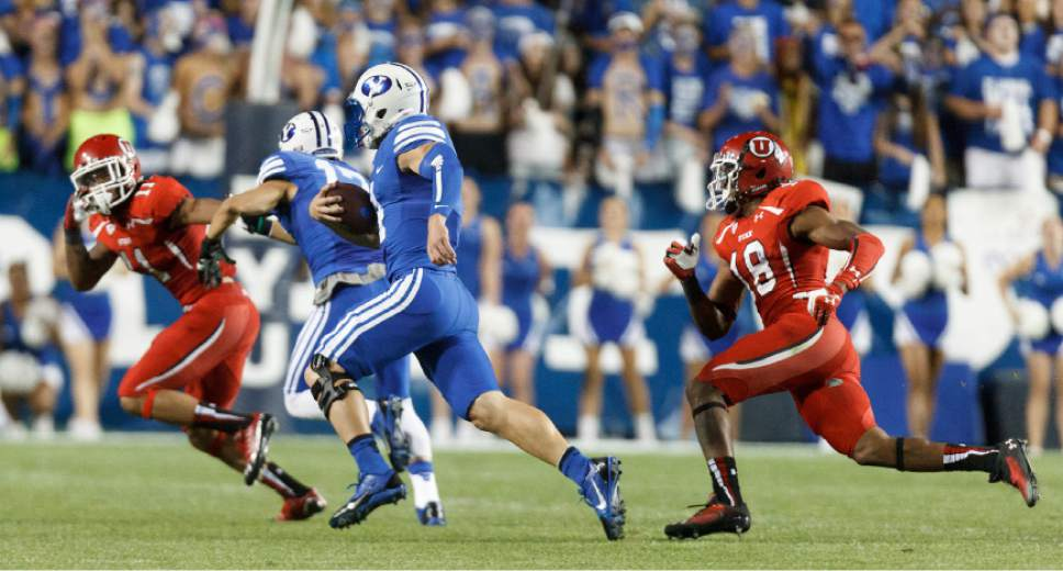 Trent Nelson  |  The Salt Lake Tribune Brigham Young Cougars quarterback Taysom Hill (4) runs the ball in the third quarter as the BYU Cougars host the Utah Utes, college football Saturday, September 21, 2013 at LaVell Edwards Stadium in Provo.