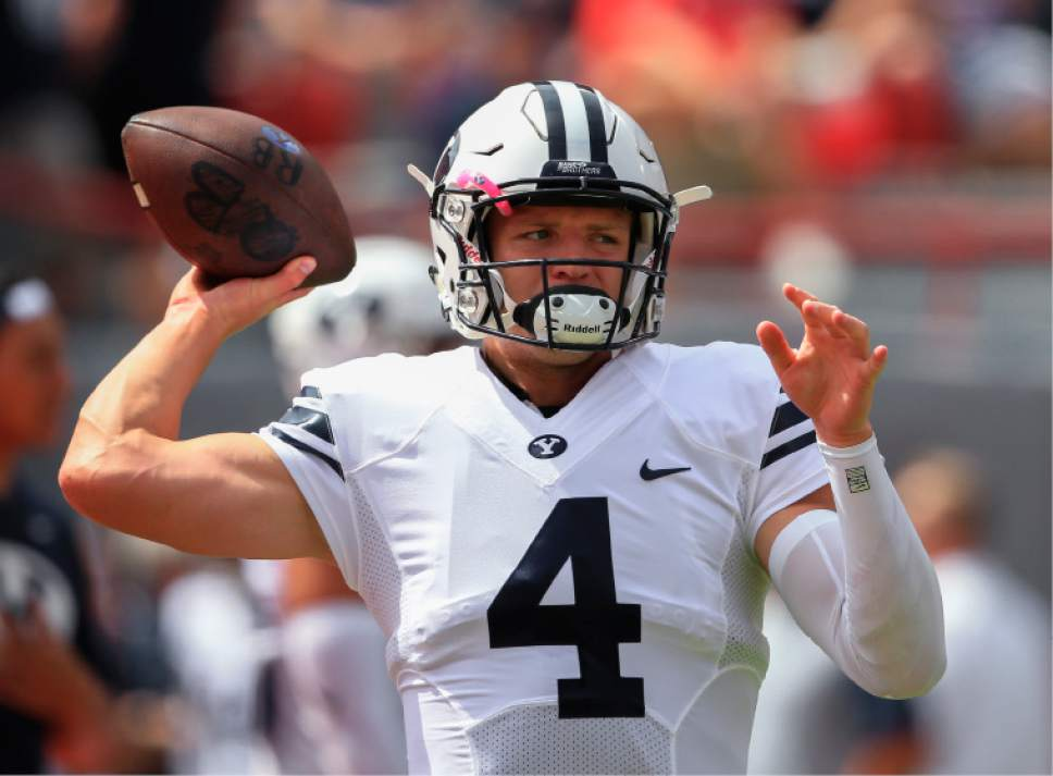 Brigham Young quarterback Taysom Hill (4) throws before an NCAA college football game against Nebraska in Lincoln, Neb., Saturday, Sept. 5, 2015. (AP Photo/Nati Harnik)