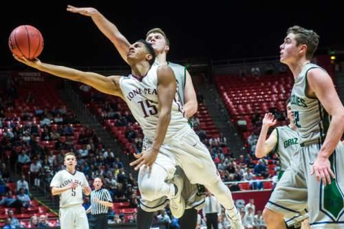 Chris Detrick     The Salt Lake Tribune Lone Peak's Frank Jackson shoots past Copper Hills' Porter Hawkins (11) during the 5A boy's basketball tournament in March.