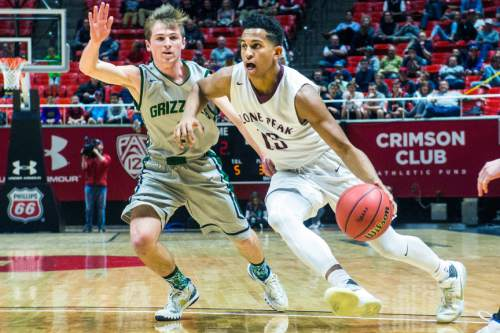 Chris Detrick     The Salt Lake Tribune Lone Peak's Frank Jackson (15) runs by Copper Hills' Trevor Hoffman (2) during the 5A boy's basketball tournament at the Huntsman Center at the University of Utah Thursday March 3, 2016. Copper Hills is winning the game 33-22 at halftime.