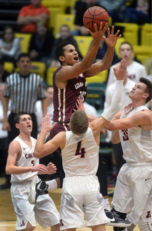 Steve Griffin     The Salt Lake Tribune   Lone Peak's Frank Jackson rises up as he shoots over the American Fork defense during boy's basketball game at Utah Valley University in Provo, Wednesday, January 20, 2016.