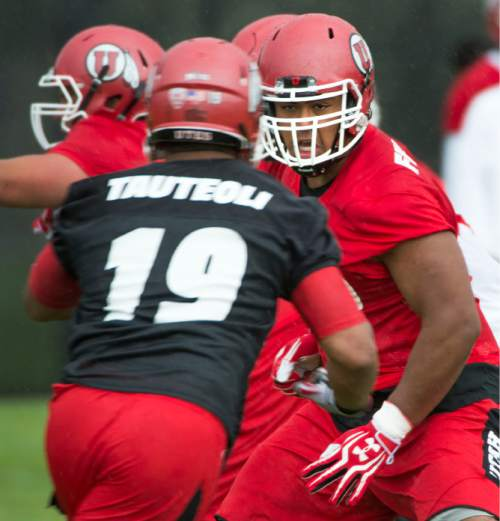 Steve Griffin  |  The Salt Lake Tribune   University of Utah offensive lineman Lo Falemaka looks to block linebacker Sunia Tauteoli (19) during second day of the teams fall camp at the University of Utah baseball field  in Salt Lake City, Friday, August 7, 2015.