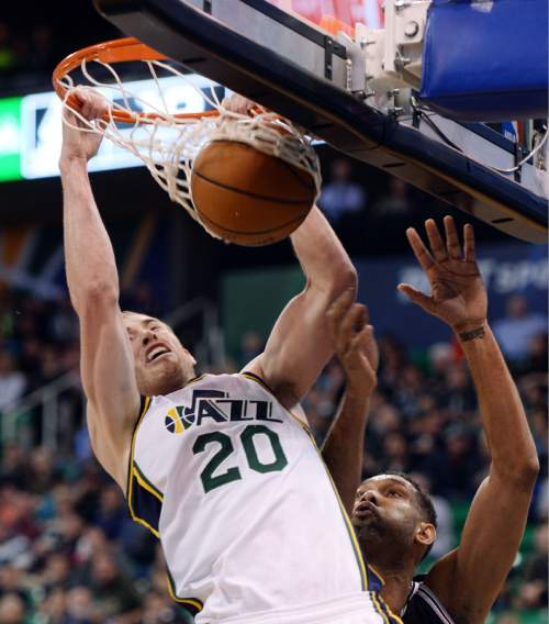 Steve Griffin  |  The Salt Lake Tribune   Utah Jazz forward Gordon Hayward (20) hammers home a dunk over San Antonio Spurs center Tim Duncan (21) during the Jazz versus Spurs NBA basketball game at Vivint Smart Home Arena in Salt Lake City, Tuesday, April 5, 2016.