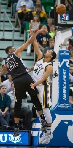 Steve Griffin  |  The Salt Lake Tribune   San Antonio Spurs center Tim Duncan (21) shoots over Utah Jazz forward Trey Lyles (41) during the Jazz versus Spurs NBA basketball game at Vivint Smart Home Arena in Salt Lake City, Tuesday, April 5, 2016.