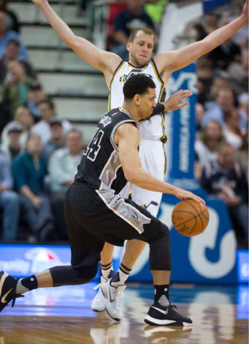 Steve Griffin  |  The Salt Lake Tribune   San Antonio Spurs guard Danny Green (14) pushes Utah Jazz forward Joe Ingles (2) as he tries to drive during the Jazz versus Spurs NBA basketball game at Vivint Smart Home Arena in Salt Lake City, Tuesday, April 5, 2016.