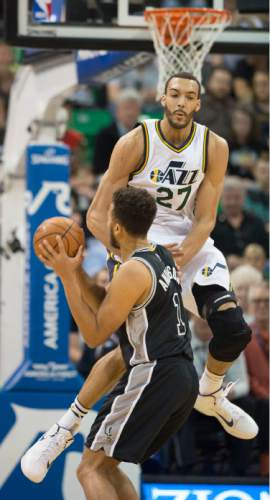 Steve Griffin  |  The Salt Lake Tribune   Utah Jazz center Rudy Gobert (27) crashes into San Antonio Spurs forward Kyle Anderson (1) and is called for a foul during the Jazz versus Spurs NBA basketball game at Vivint Smart Home Arena in Salt Lake City, Tuesday, April 5, 2016.