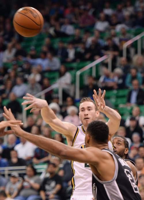 Steve Griffin  |  The Salt Lake Tribune   Utah Jazz forward Gordon Hayward (20) fires a pass over San Antonio Spurs center Tim Duncan (21) during the Jazz versus Spurs NBA basketball game at Vivint Smart Home Arena in Salt Lake City, Tuesday, April 5, 2016.