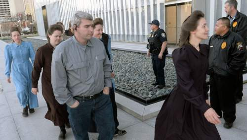 Al Hartmann  |  The Salt Lake Tribune  FLDS men and women march together to Lyle Jeffs' detention status hearing Wednesday April 6 at the Federal Courthouse in Salt Lake City.