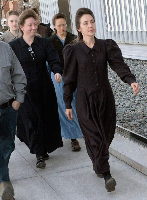Al Hartmann  |  The Salt Lake Tribune  FLDS men and women march together to Lyle Jeffs' detention status hearing Wednesday April 6 at the Federal Courthouse in Salt Lake City.  Pauline Barlow, senior wife of Lyle Jeffs, at right.