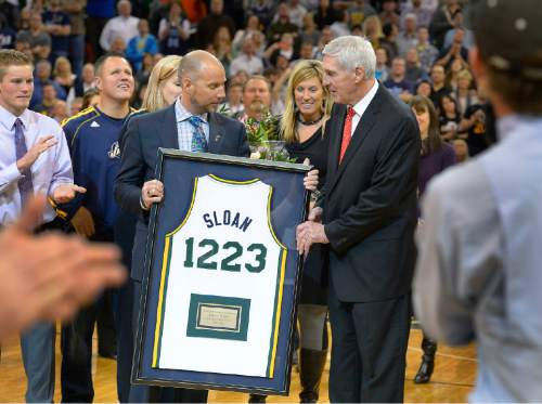 Scott Sommerdorf   |  The Salt Lake Tribune  Steve Miller hands Jerry Sloan a commemorative jersey with noting his total NBA victories as he was honored during halftime as the Jazz hosted the Golden State Warriors, Friday, Jan. 31, 2014.