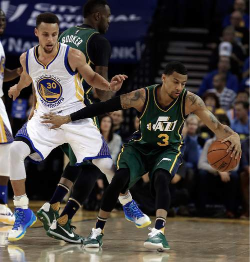Golden State Warriors' Stephen Curry, left, guards Utah Jazz's Trey Burke (3) during the first half of an NBA basketball game Wednesday, March 9, 2016, in Oakland, Calif. (AP Photo/Ben Margot)