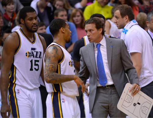 Leah Hogsten  |  The Salt Lake Tribune Utah Jazz guard Trey Burke (3) talks with Utah Jazz head coach Quin Snyder at a timeout. Oklahoma City Thunder lead 52-44 over the Utah Jazz at the half at Vivint Smart Home Arena, Friday, December 11, 2015.