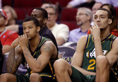Utah Jazz's Trey Burke, left, and Rudy Gobert, right, sit on the bench during the second half of an NBA basketball game against the Houston Rockets on Wednesday, April 15, 2015, in Houston. The Rockets won 117-91. (AP Photo/David J. Phillip)