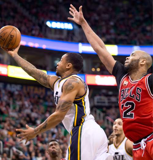 Lennie Mahler  |  The Salt Lake Tribune  Trey Burke drives past Taj Gibson in the first half of a game between the Utah Jazz and the Chicago Bulls on Monday, Feb. 1, 2016, at Vivint Smart Home Arena.