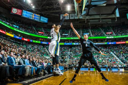 Chris Detrick  |  The Salt Lake Tribune Utah Jazz guard Trey Burke (3) shoots over Minnesota Timberwolves guard Zach LaVine (8) during the game at Vivint Smart Home Arena Friday January 29, 2016.