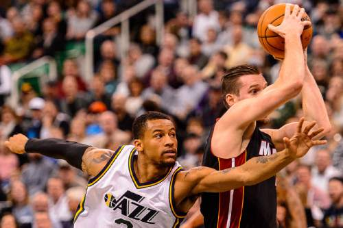 Trent Nelson  |  The Salt Lake Tribune Utah Jazz guard Trey Burke (3) defends Miami Heat guard Beno Udrih (19) as the Utah Jazz host the Miami Heat, NBA basketball in Salt Lake City, Saturday January 9, 2016.