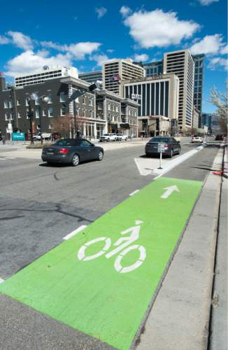 Steve Griffin  |  The Salt Lake Tribune   Bike lane and curb protecting it on 300 South near 200 West in Salt Lake City, Tuesday, April 5, 2016.