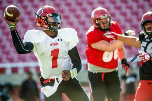 Chris Detrick  |  The Salt Lake Tribune Utah Utes quarterback Tyler Huntley (1) passes the ball during a practice at Rice-Eccles Stadium  Tuesday April 5, 2016.