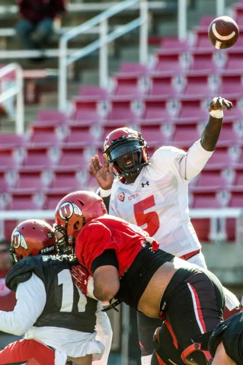 Chris Detrick  |  The Salt Lake Tribune Utah Utes quarterback Brandon Cox (5) throws the ball during a practice at Rice-Eccles Stadium  Tuesday April 5, 2016.