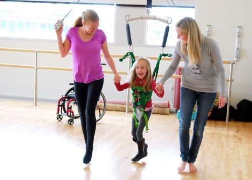 Audrey Sterner, a student in the Tanner Dance Program at the University of Utah, moves in a harness alongside her mom, Trista, and teacher Elise Miller as part of a Dancers with Disabilities class. Courtesy  |  Mary Anne Stewart Anderson