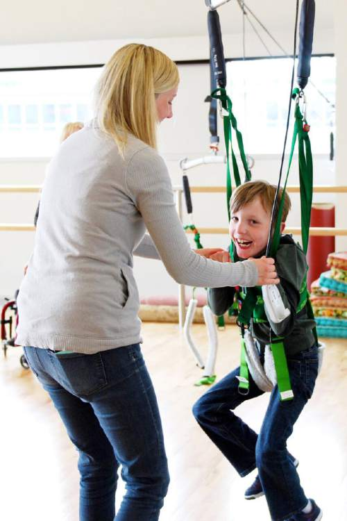 Ryan Sterner, with his mom, Trista, moves in a harness as part of Tanner Dance's Dancers with Disabilities program at the University of Utah. Courtesy  |  Mary Anne Stewart Anderson