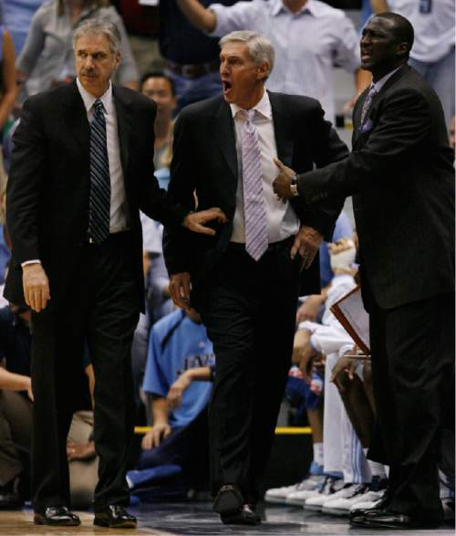 Steve Griffin  |  The Salt Lake Tribune  Utah Jazz head coach Jerry Sloan is held back by assistant coach Phil Johnson (left) and Tyron Corbin during second half action of the Jazz, Spurs NBA Western Conference Finals game 4 at the EnergySolutions Arena in Salt Lake City May 28, 2007.