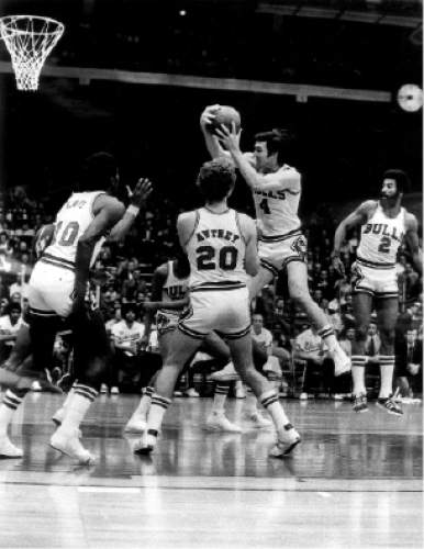 Phil Mascione  |  Chicago Tribune Photo  Jerry Sloan pulling down a rebound amidst a head of Bulls.
