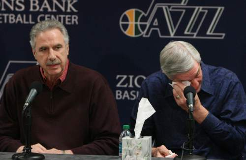 Leah Hogsten  |  The Salt Lake Tribune  l-r Phil Johnson, Jerry Sloan show their emotions during their resignation speeches.  Jerry Sloan resigned as coach of the Jazz on Thursday, February 10, 2011, in Salt Lake City, bringing to a stunning end a long career in Utah that included most of his 1,221 career coaching victories and induction into the basketball hall of fame.Longtime assistant coach Phil Johnson also resigned.  Assistant coach Tyrone Corbin will be named interim head coach. The announcement was given at  a press conference at 3 p.m. at the team's practice facility.
