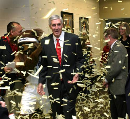 Steve Griffin  |  The Salt Lake Tribune  Jerry Sloan walks through a shower of confetti, shot from a canon by the Jazz Bear, as he attends the Utah Sports Hall of Fame banquet at EnergySolutions Arena in Salt Lake City, Utah Wednesday, November 16, 2011. Sloan along with Phil Johnson, Doug Toole, Natalie Williams and Annette Ausseresses were all inducted into the hall of fame.