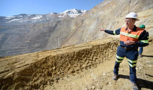 Al Hartmann  |  The Salt Lake Tribune  Rio Tinto's David Meador points to the western wall of Bingham Canyon Mine that has had small movements and a small slide recently.  Kennecott uses sophisticated monitoring and detection systems in additional to hundreds of trained eyes in its everyday operation to scan and detect movement and keep people safe. State of the art GroundProbe slope stability radars, prisms and other systems are used to detect movement in the walls of the Bingham Canyon Mine.