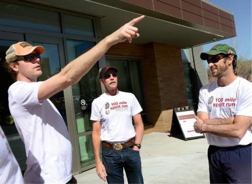 Scott Sommerdorf      The Salt Lake Tribune   University of Utah law student Will Edwards, left, points out the route runners will run in support of their Dean Robert Adler, center, Thursday, April 7, 2016. Adler is competing in a 100-mile foot race in Zion National Park this weekend. The run was organized by Edwards and Tyler Bugden, right. Adler wants to draw attention to his school's push for 100 percent of students to pass the American Bar Association exam and also get a job.