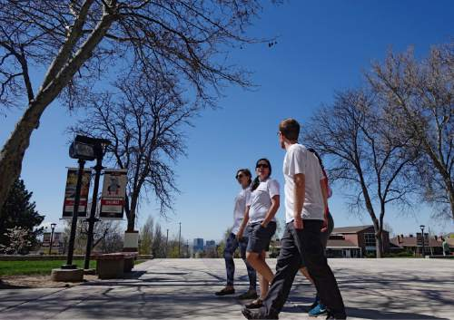 Lennie Mahler     The Salt Lake Tribune  University of Utah law students Liz Thomas, Megan Mustoe, Erika Larsen and Eric Ashton walk a mile route around campus Thursday, April 7, 2016. Law students and faculty worked to accumulate a total of 100 miles before law school dean Robert Adler runs a 100-mile course in Zion National Park on Friday. Adler will run the ultra-marathon to push for a 100% bar exam passage rate and 100% employment for law graduates.