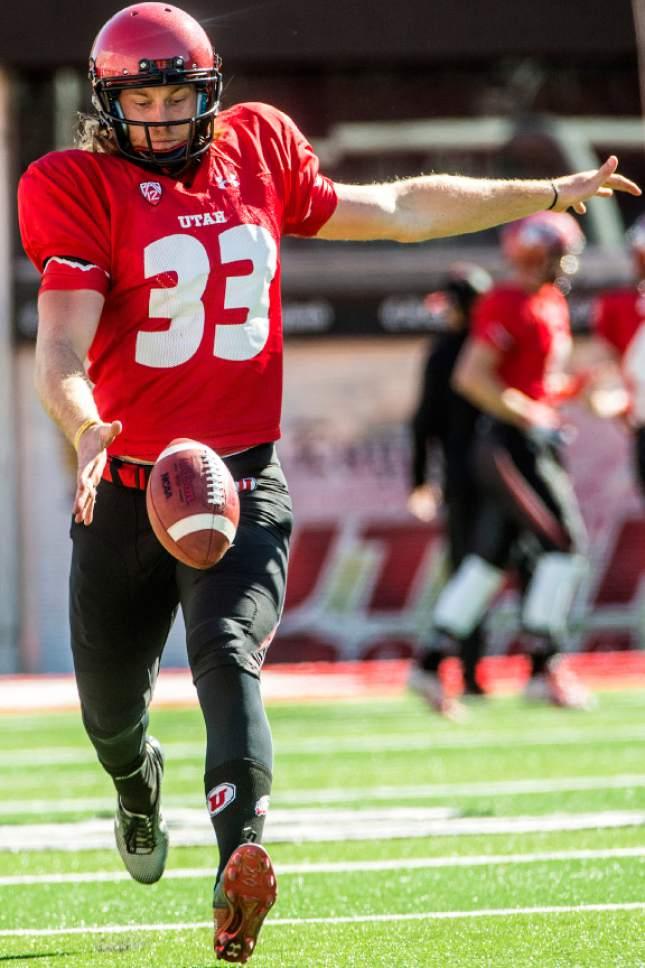 Chris Detrick  |  The Salt Lake Tribune Utes punter Mitch Wishnowsky (33) kicks the ball during a practice at Rice-Eccles Stadium Tuesday April 5, 2016.
